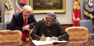 Conned? President Donald Trump appears to be up to something as President Muhammadu Buhari signs the visitors register