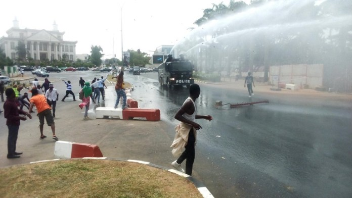 FILE PHOTO: Shiite protesters pelting stones at a Nigerian Police armoured tank
