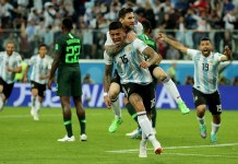Lionel Messi celebrates with Marcos Rojo as they celebrate Argentina's winning goal