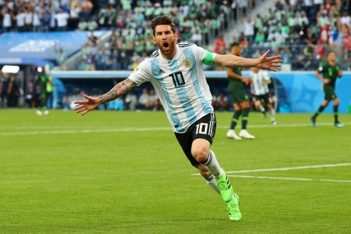 FILE PHOTO: Lionel Messi wheels away after scoring his first World Cup goal against Nigeria