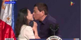 President Rodrigo Duterte kisses an oversee worker in South Korea