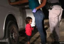 US immigration officer separating a child from her mother following Trump's zero tolerance policy
