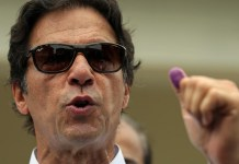 Ex-cricketer Imran Khan in early lead in Pakistan election