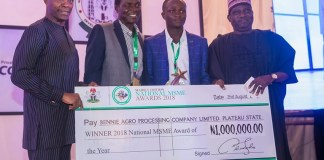 FILE PHOTO: Prof Yemi Osinbajo presents a cheque to MSME winner in Abuja MSMEs Awards
