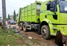A Visionscape truck collecting waste on Abaranje road, Ikotun in Lagos