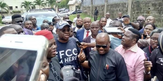 Ayodele Fayose, former Ekiti State governor wearing a self-styled EFCC shirt