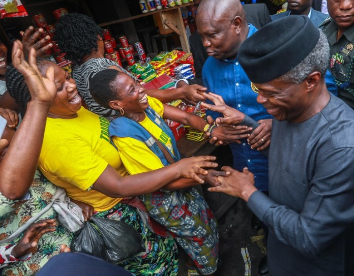 FILE PHOTO: Vice President Yemi Osinbajo during an on-site assessment of Tradermoni