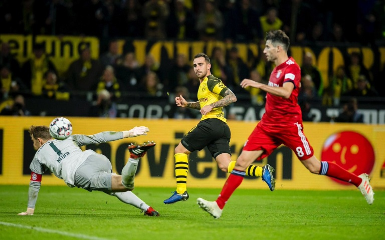 Paco Alcacer scores again as Borussia Dortmund comes from behind to beat Bayern Munich and stretch lead at the top