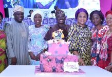 Lagos State Governor, Mr. Akinwunmi Ambode (2nd left), with his wife, Bolanle (left); Oyo State Governor, Sen. Abiola Ajimobi (right) and his wife, Florence (2nd right) during the closing of 2018 National Women Conference organised by the Oyo State Officials Wives Association (OYSOWA), at the International Conference Centre, University of Ibadan, Oyo State, on Friday, November 30, 2018