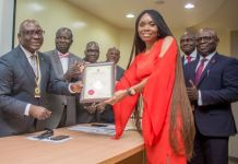 UBA Group Head Human Resources, Mrs Patricia Aderibigbe receiving the Certificate of Accreditation to UBA Academy