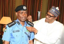 President Buhari decorates Mohammed Adamu as acting Inspector General of Police