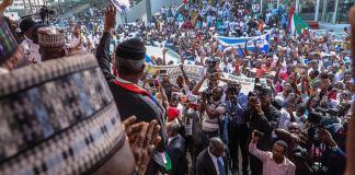 VP Yemi Osinbajo addressing the people during the drive for Buahri Osinbajo Campaign Rally