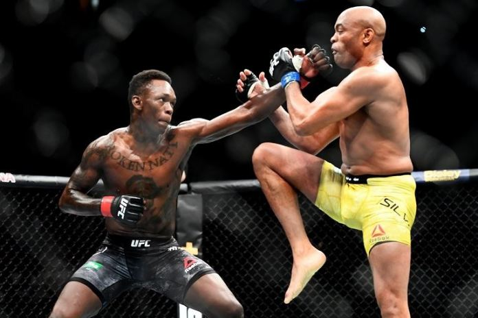 Israel Adesanya lands a punch to the face of his idol, 43-year-old Anderson Silva, at UFC 234