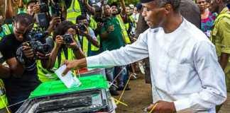 Vice President Yemi Osinbajo casting his vote at the Victoria Garden City