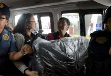 Maria Ressa was arrested at the airport and conveyed in a police car