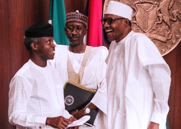 President Muhammadu Buhari shares a joke with Vice President Yemi Osinbajo during a special FEC meeting