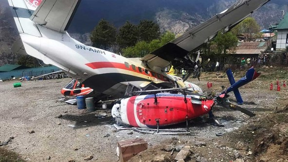 A Summit Air Let L-410 Turbolet aircraft bound for Kathmandu is seen after it hit two helicopters during take off at Lukla airport, the main gateway to the Everest region