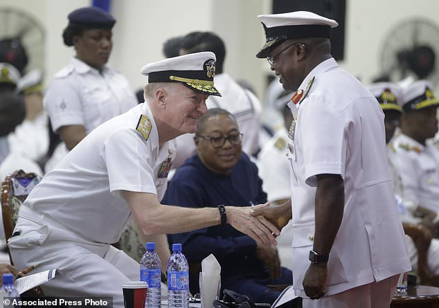 Admiral Ibok-Ete Ekwe Ibas, right,Nigeria Chief of Naval Staff, shakes hands with Adm. James G. Foggo III, U.S. Naval Forces Europe-Africa and commander, Allied Joint Force Command Naples, during the closing ceremony of exercise Obangame in Lagos, Nigeria