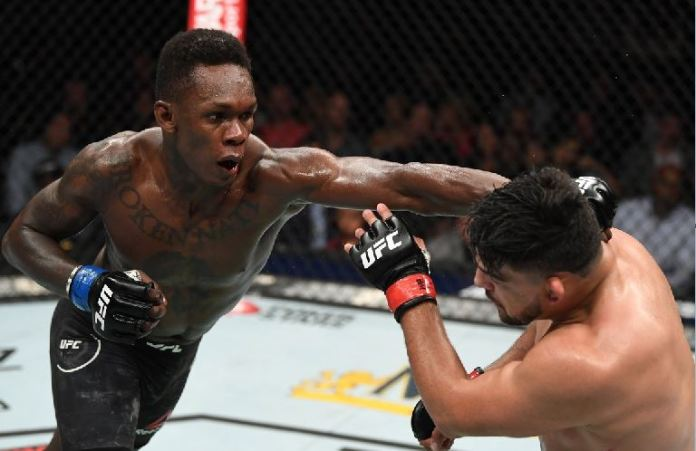 Israel Adesanya lands a combination of punches to the face of Kevin Gastelum to win the interim UFC middleweight belt
