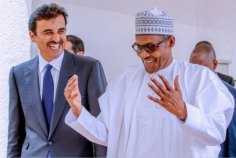 President Muhammadu Buhari chats with the Emir of Qatar in Abuja, Nigeria's capital