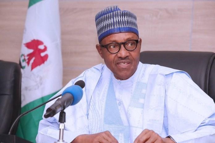 President Muhammadu Buhari signs the new minimum wage