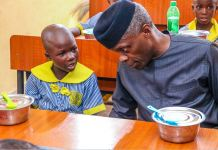 A St. Michael's African Primary School, Ado Ekiti pupil chatting with Vice President Yemi Osinbajo