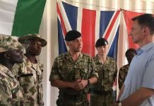 Foreign Secretary Jeremy Hunt interacting with Nigerian troops during his visit to the West African country