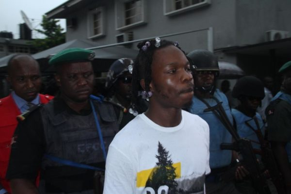 Naira Marley accompanied by EFCC officials after his sentencing