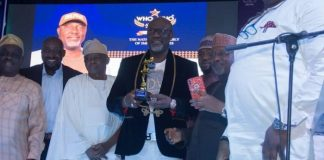 Senator Dino Melaye with his award as Senator of the Year