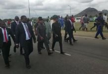 Vice President Yemi Osinbajo walks towards the protesters en route the airport on Tuesday