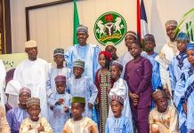 President Muhammadu Buhari and Vice President, Yemi Osinbajo with children who came to pay Eid-El-Fitr Homage at the State House