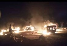 Vehicles were burnt and scores killed in the violent attack on Jalingo