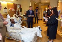 Mr Dauda Handan in the hospital after he was shot by the police