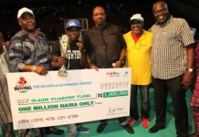 Adewunmi Ogunsanya presenting cheque at the maiden Lagos State Inter-club Boxing Challenge