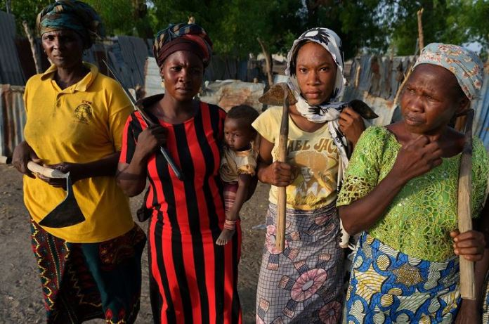 Sarah James, at left, with others living near the Maimalari barracks in Maiduguri. The women said they gave up land they had farmed for years to make way for the expansion of the base's cemetery.