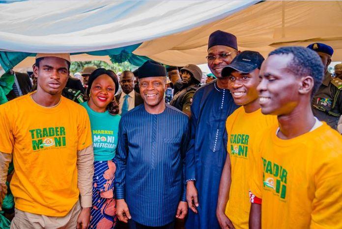 Vice President Yemi Osinbajo with some beneficiaries of TraderMoni and MarketMoni