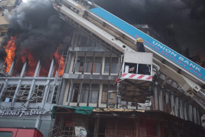 A policeman has been killed after a building was ravaged by fire