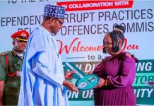 President Muhammadu Buhari honours Josephine Ugwu who returned N12million found at the airport