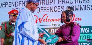 President Muhammadu Buhari honours Josephine Ugwu who returned N12million found at the airport