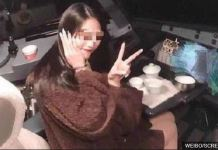 The female passenger is seen here with her fingers in a V pose, also known as the peace sign