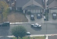 Police surround house after school shooting