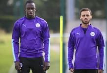Manchester City's Benjamin Mendy (left) and Bernardo Silva