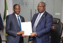 Mr. Babatunde Fowler, former Chairman, Federal Inland Revenue Service (FIRS), handing over to Mr. Abiodun Aina, Coordinating Director, FIRS, at the FIRS office on Monday