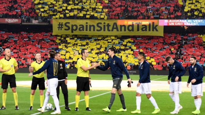 The 'Spain, sit and talk' message was on display inside the Nou Camp as well