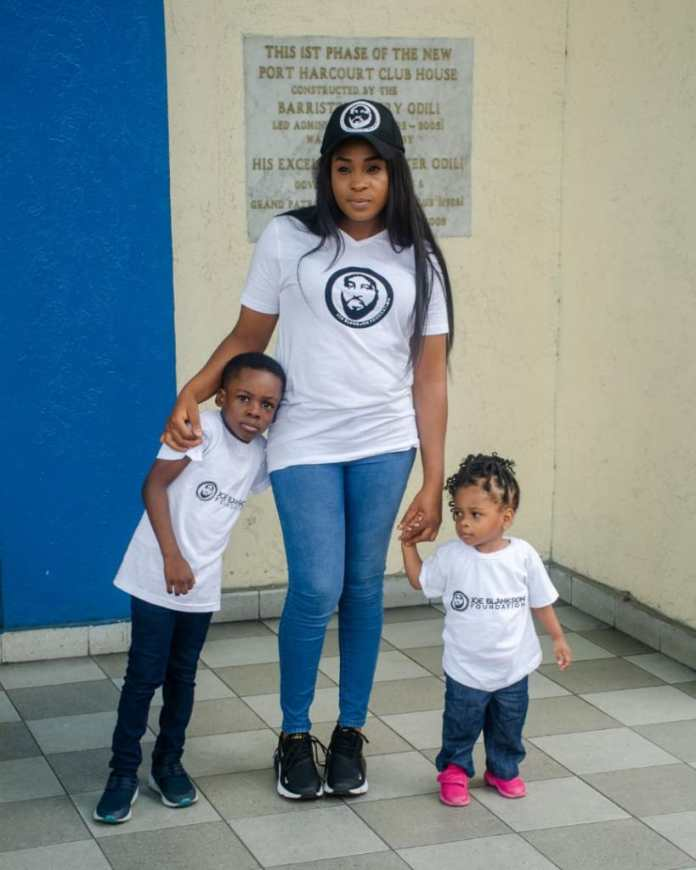 Mrs Blankson and her two children dorning Joe Blankson's memorial shirt