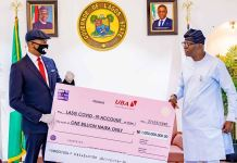 UBA Group MD/CEO, Kennedy Uzoka presents a N1 billion cheque to Governor Babajide Sanwo-Olu