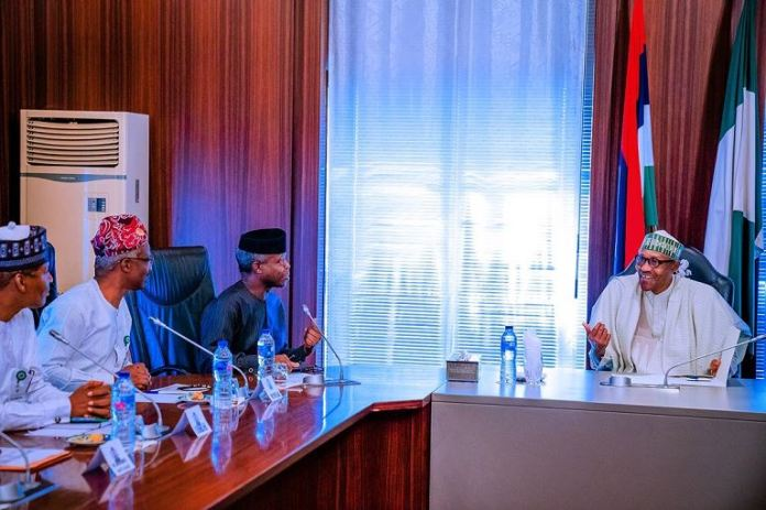 President Buhari oversees the Economic Advisory Council meeting with VP Osinbajo in attendance