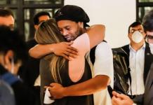 Ronaldinho was met by friends at the hotel in Asuncion