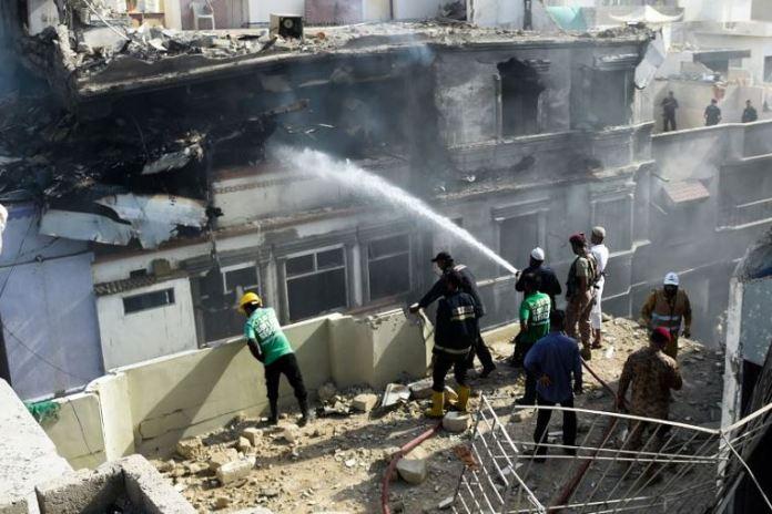 Pakistan fire fighters battling the plane crash