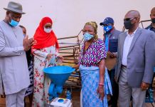 Festus Keyamo (SAN) HMS Labour, Sadiya Umar Farouq, HM, FMHDSD, a trader Mrs. Okolie and DG NEMA, AVM Muhammadu Alhaji Muhammed (Rtd.) during her visit to Ogbeogonogo market Asaba (Source Ministry)